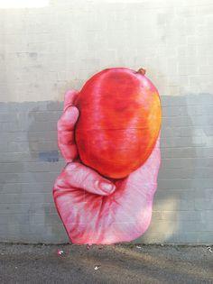 Hand with a Mango (by gaia.streetart)