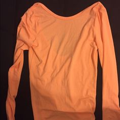 Peach long sleeve top Victoria's Secret Peach top from Victoria's Secret. The back on this is really cute! Scooped back. Long sleeve. New with tags. Size small Victoria's Secret Tops Tees - Long Sleeve