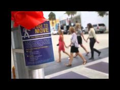 Ft. Lauderdale has started a pedestrian crossing flag program at the intersection of Southeast 13th avenue and Las Olas Boulevard. Video by Patrick Farrell / Miami Herald staff