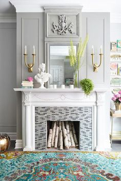 Bright White Fireplace - 6 Instant Ways to Give Your Fireplace a Summertime Makeover - Southernliving. Old-World elements paired with pops of bright green and pink create a fresh, summertime look for this fireplace. See more at The Decorista