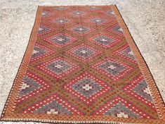 11'1 x 6'8 Red and brown Kilim rug area