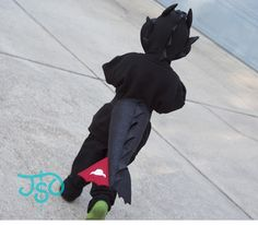 Fun DIY costumes - Toothless the dragon and a Great White Shark from modified hoodies and homemade tails.