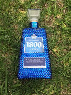 Blue bedazzled 1800 liquor bottle by TheRusticSkull on Etsy