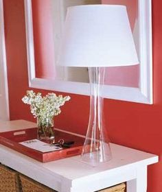 A table lamp casts an inviting glow, too. Keep the base slim so the lamp doesn't feel overwhelming, especially on a slender console table. | Looking to add vigor to your vestibule, fizz to your foyer? Try these easy ideas.