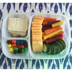 Lunch packed - snack style! Crunchy fresh veggies, cheese, crackers and a treat! #EasyLunchboxes