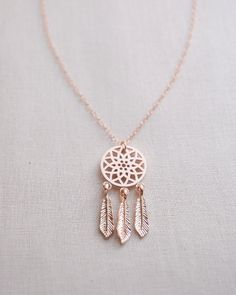 Dreamcatcher Necklace by Olive Yew. Let this small rose gold dreamcatcher charm keep all the bad dreams away. Also available in silver and gold.