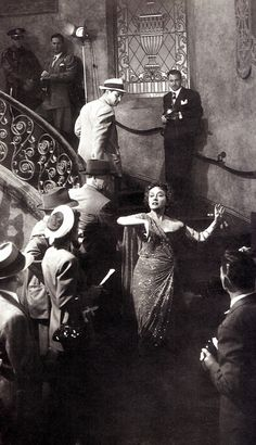 GLORIA SWANSON as Norma Desmond the now delusional great silent star, who glides down her staircase thinking she is making another movie. SUNSET BOULEVARD (1950) 'All right, Mr De-Mille, I'm ready for my close-up' from Great Movie Portraits (the Kobal Collection) by John Russell Taylor (please follow minkshmink on pinterest) #sunsetboulevard #gloriaswanson #staircase