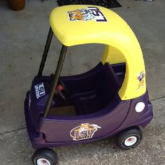 My husband painted this Cozy Coupe for our 18 month old son.  He used Rust-oleum spray paint in purple and sun yellow. Both in gloss.   Geaux Tigers!!!!