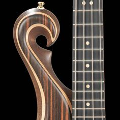 Exotic bass scroll with macassar ebony top, maple accent