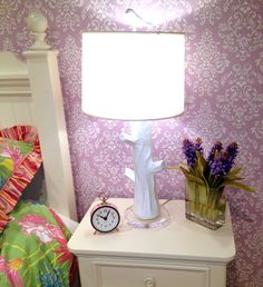 Cool eclectic display for a girls room. Love the colors and that unique lamp!