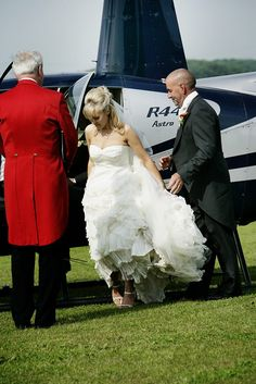 Elegant bride steps out of Aeroplane at a luxury wedding planned by Kim Balasubramaniam