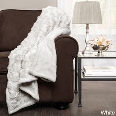 A circular ribbon embroidered design lends texture and terrific style to this Emma throw blanket by Lush Decor. Available in white or ivory, this swirling throw is sure to bring eye-catching style to any bedroom or living space.