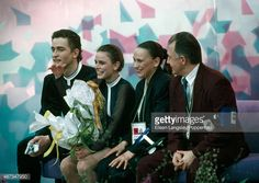 Sergei Grinkov and Ekaterina Gordeeva of Russia with their coaches await the results of their performance in the pairs figure skating event during the Winter Olympic Games in Lillehammer, Norway, circa February 1994. The couple won the gold medal in the event.