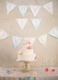 Textured Ivory Buttercream Cake with Bunting by The Cakery Bakery https://www.theknot.com/marketplace/the-cakery-bakery-st-louis-mo-369845 | Chadler Hill Vineyards – Defiance, Missouri https://www.theknot.com/marketplace/chandler-hill-vineyards-defiance-mo-644016 | Floral Arrangements by Les Bouquets https://www.theknot.com/marketplace/les-bouquets-stlouis-mo-251909 | Lisa Hessel Photography https://www.theknot.com/marketplace/lisa-hessel-photography-saint-louis-mo-336708