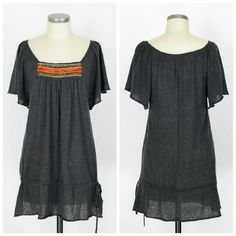 "Free People wool tunic Sz L. Free People wool tunic in charcoal. Short sleeves. Long length styling. Ties at bottom. 75% wool 20% polyester 5% cashmere. Excellent condition, no flaws. Approx measurements Bust 36"" Length 31.5"". Free People Tops Tunics"