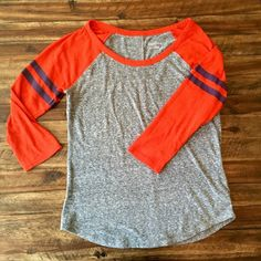 Merona Comfy Baseball Tee Soft and comfy Merona baseball T in the gray and orange with navy stripes on the sleeve. Would be perfect for cheering on Auburn! Worn a handful of times but in good condition.  Sleeves are three-quarter length. Merona Tops Tees - Long Sleeve