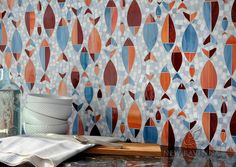 Floating Fish, a water jet jewel glass mosaic shown in Mica, Sardonyx, Garnet, Pearl, and Quartz, is part of the Erin Adams Collection for New Ravenna Mosaics.<br /> Take the next step: prices, samples and design help, http://www.newravenna.com/showrooms/