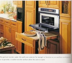 The L Shaped Kitchen Design Centers On A Wrap Around Island That Is. Drop  Down Door Microwave ...
