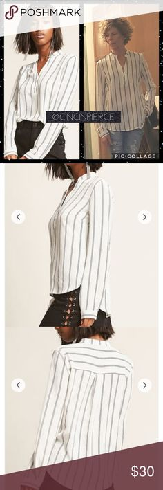 FOREVER 21 ~ PINSTRIP BLOUSE WHITE & BLACK BLOUSE, BAND COLLAR, LONG BUTTON-CUFF SLEEVE & CURVED HIGH LOW HEM. SEMI SHEER FINISH.  SIZE MEDIUM  97% POLYESTER  3% SPANDEX Forever 21 Tops Blouses