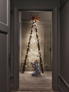 What a clever idea! Just wrap fairy lights around a fold out ladder, add a star and some decorations (and a lot of love) and there you have it!