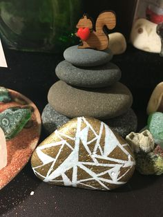"""Gwen says, """"Look at this way cool abstract painted stone I got. It's going to add much needed pizzaz to my refrigerator bulletin board! Thank you!""""  The pic was taken in my Flash Mob puja zone and you can catch a glimpse of my Jetty sea glass, my squirrel's nude beach, a barnacle rock and a sweet squirrel that Christy sent me."""