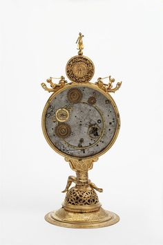 antique clock (1564), Gilt brass with enamelled silver dial ring