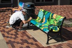 Art takes a seat downtown: Boyfriend beautifies benches in Iowa City. | Iowa Now. Article and photos by Bill Adams.