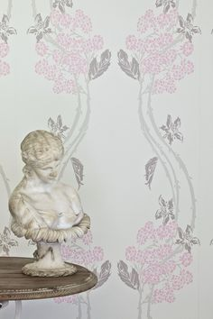 Pretty berries adorn this lovely pink wallpaper pattern by Barneby Gates.