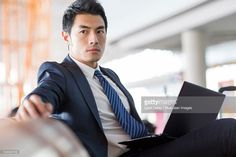 Stock Photo : Young businessman using laptop in airport