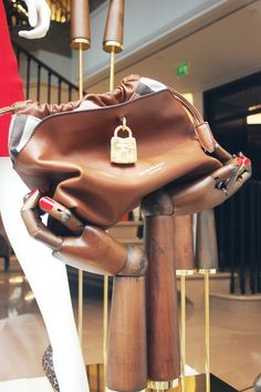 lock it or lose it, Burberry, London, pinned by Ton van der Veer Find wooden mannequin hands like these at Mannequin Madness