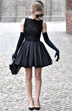 Holly Golightly meets Pixie Lott with this flared pleated skirt in black.