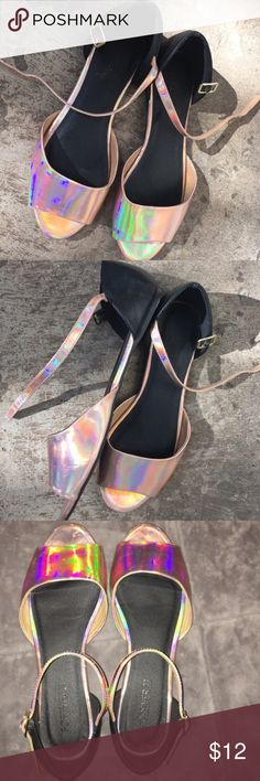 Pretty pink holographic flats Size 8. Only worn twice. These got me a ton of compliments! Color is a pink holographic hue, has some gold tones in certain lights. Super cute and tons of rainbow! Forever 21 Shoes Flats & Loafers