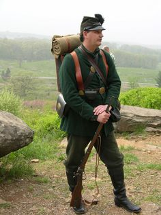 Union sharpshooters were the elite marksmen of the army.  Their green uniforms and rubber buttons were an early attempt at camouflage.  To qualify a rifleman had to put 10 out of 10 shots into a 10 inch circle at 200 yards.  (Gettysburg National Military Park)
