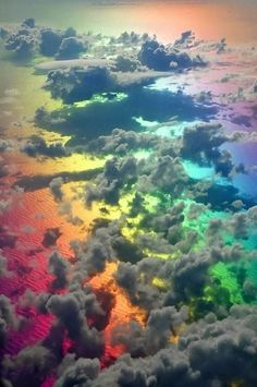 Watching a rainbow that's under the clouds viewed from an airplane /// #travel #wanderlust