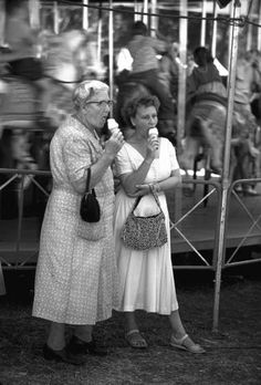 Two women enjoying ice cream cones at Iowa State Fair, 1955.