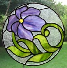 Beautiful circular art nouveau stained glass hanging panel. Round stained glass. www.treasuresoflight.com