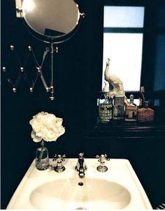 Dramatic + elegant black bath