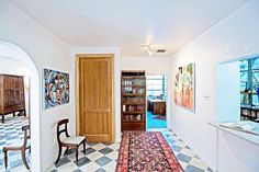 Entryway with tiled floors and traditional rug