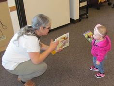 """Casle Portner, the Stayton Public Library's youth services librarian, hands out free books at the """"Free Books at Last"""" event on Monday."""