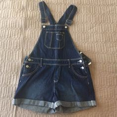Shorts Overalls Super cute shorts overalls. Originally purchased for a country concert but ended up wearing something else so NWT. It's a girls XL but fits like a juniors XS. Jordache Jeans Overalls