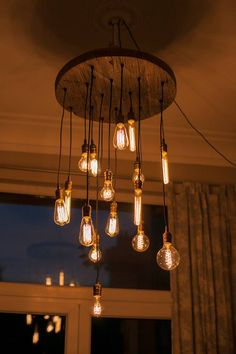 very cool edison lamp hanging in living room                                                                                                                                                     More