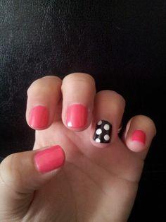 Pink nails with black nail polka dot accent