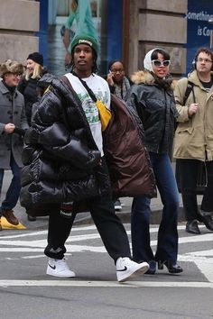 ASAP Rocky wearing  Raf Simons Oversized Jacket, Jordan 1 Retro High OG Ying Yang Pack