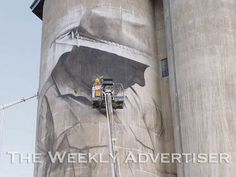 Silos at Brim are getting a makeover with artist Guido van Helten working on a mural.  The Brisbane-based artist is renowned for his street art.  Brim Active Community Group is behind the silo art project, supported by GrainCorp, Regional Arts Victoria, Marianne Ferguson, Yarriambiack Shire Council and Shaun Hossack from Juddy Roller.  The first stage of the mural, of Brim farmer Peter Martin, is nearly finished.  The artwork will extend across several silos.