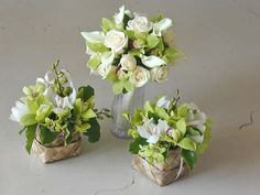 Green Cymbidium Orchids, WHite Calla Lilies and White Roses