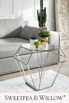 Our Eichholtz Asscher Nickel side table is a wonderful piece that is sure to add a palatial feel to your living room. It has a beautiful base made from marble and a gorgeous nickel finished frame supporting a clear glass top making it both elegant and functional. #sweetpeaandwillow #modernnickelsidetable #luxurymodernsidetable #eichholtz #modernhomedecor Sweetpea And Willow, Console Table, Dining Table, Willow Furniture, Living Room Decor, Living Spaces, Modern Art Deco, Modern Side Table, Luxury Sofa