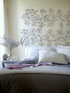 Alternative headboard. Not necessarily this piece, but like the idea of large wall hanging instead of a headboard