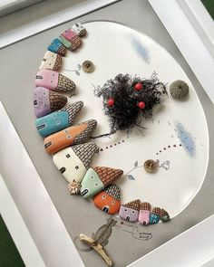 A little street of painted pebbles - cute pebble art