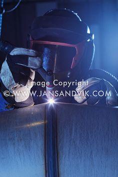 Industrial welder at work welding a stainless steel pipe. Pipe Welding, Stainless Steel Pipe, Welding Machine, Industrial, Metal, Welding Set, Industrial Music, Metals