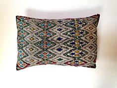 Diamond Embroidered Double Sided Cushion  This unique cushion injects a burst of colour to your space. With it's intricate geometric embroidery on one face and a simple, bright red with multi-coloured stripes on the backing, this cushion can change to suit your mood.  35 x 50cm Geometric Embroidery, Embroidered Cushions, Soft Furnishings, Your Space, Stripes, Suit, Bright, Change, Mood